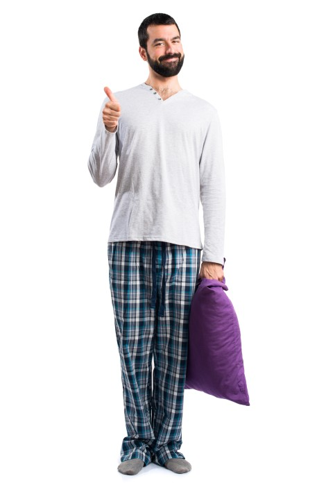 Man in pajamas with thumb up